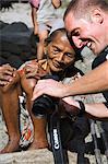 Local elderly Igorot woman and western tourist with camera, Tulgao Village, near Tinglayan Town, The Cordillera Mountains, Kalinga Province, Luzon, Philippines, Southeast Asia, Asia