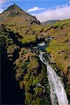 Waterfall in the west of the country, Arnarstapi, Snaefellsjokull (Snaefellsnes) Peninsula, Iceland