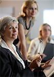 Three women having seminar in office