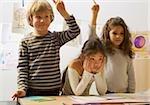 Three schoolchildren in classroom
