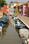 Coloured houses alongside canal, moored fishing boats, Burano, Venetian Lagoon, Veneto, Italy, Europe