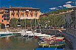 The harbour and waterside cafe, Torre del Benaco, Lake Garda, Veneto, Italy, Europe