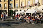 People sitting outside a cafe on Karlsplatz, Munich, Bavaria, Germany, Europe