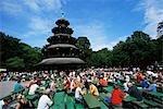 People sitting at the Chinese Tower beer garden in the Englischer Garten, Munich, Bavaria, Germany, Europe