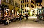 People sitting at outdoor cafes and restaurants, Hans im Gluck Platz, Stuttgart, Baden Wurttemberg, Germany, Europe