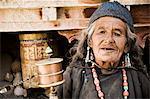 Portrait of Indian woman with prayer wheel, Lamayuru, Ladakh, Indian Himalayas, India, Asia