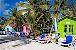 Beach cabana and woman, Princess Cays, Eleuthera Island, Bahamas, West Indies, Central America