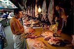 Man buying fresh meat at market, Xining, Qinghai, China, Asia