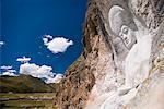 Buddha image carved into cliff side, Yushu, Qinghai, China, Asia