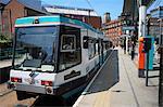 Metrolink tram at tram stop, Manchester, England, United Kingdom, Europe