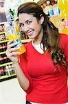 Woman holding a bottle of orange juice