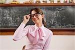 Female teacher adjusting her eyeglasses and smiling