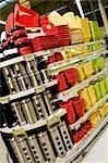 Kitchen utensils on shelves in a supermarket