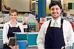 Sales clerks smiling in a supermarket
