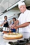 Chef preparing pizza in the kitchen