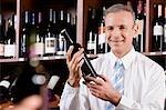 Businessman holding a wine bottle