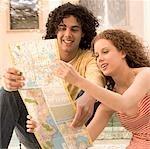 Couple looking at a map and smiling,Biltmore Hotel,Coral Gables,Florida,USA