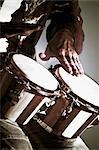 Close-up of a man playing a bongo