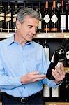 Man choosing wine in a supermarket