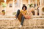 Couple having fun near a fountain,Biltmore Hotel,Coral Gables,Florida,USA