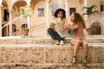 Couple looking at a map,Biltmore Hotel,Coral Gables,Florida,USA