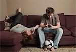 Boys using mobile phones