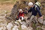 senior couple hiking in mountains