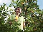 Woman With Glass Of Fresh Orange Juice