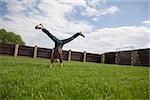 A girl doing a cartwheel