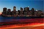 Traffic and cityscape at dusk,Manhattan,New York City,NY,USA