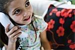 Little girl using landline phone