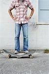 Man with Broken Skateboard