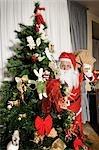 Santa Claus by Christmas Tree