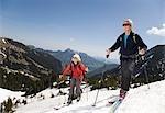 senior couple on ski tour in mountains