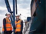 Port Workers Beside Loaded Ship