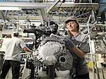 Car Workers Building Car Parts