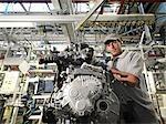 Car Worker Building Car Parts
