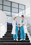 Doctors walking down staircase in hospital