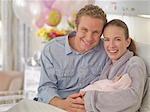 Couple holding newborn baby