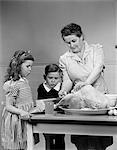 1940s MOTHER SON DAUGHTER KITCHEN TURKEY DINNER