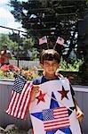 BOY WEARING U.S. FLAG FOR FOURTH OF JULY