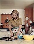 1970s WOMAN KITCHEN BAKING COOKIES APRON MIXING BOWL