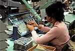 1970s WOMAN ASSEMBLING COMPUTER