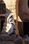 KSAR OULED SOLTANE, TUNISIA BERBER MAN ON STEPS OF GHORFA