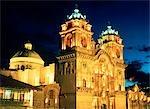 CUZCO, PERU IGLESIA DE LA COMPANIA ON PLAZA DE ARMAS AT NIGHT