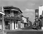 1960s FRENCH QUARTER NEW ORLEANS STREET SCENE