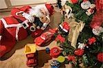 Santa Claus Asleep by the Christmas Tree