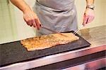 Close-up of Man Preparing Salmon