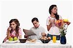 Bored family having breakfast together