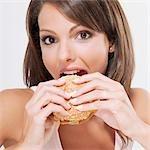 Portrait of a woman eating a hamburger